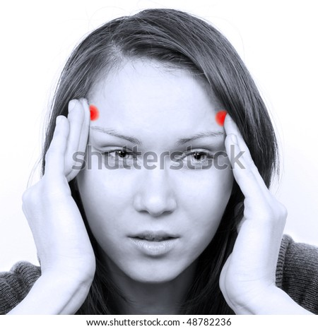 Young woman with a headache - stock photo