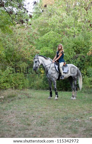 young woman with a horse outdoor - stock photo