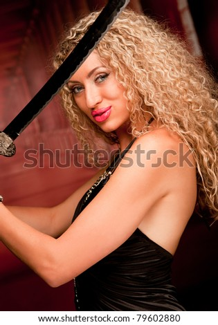 Young woman with a japanese sword