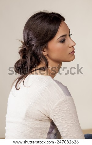 young woman with a loosely clenched hair - stock photo