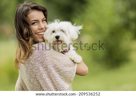 Young woman with a maltese dog - stock photo