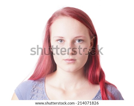 young woman with a neutral expression on her face - stock photo