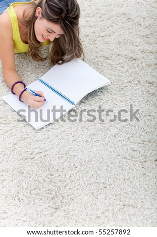 Young woman with a notebook studying at home - stock photo