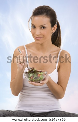 Young woman with a salad - stock photo