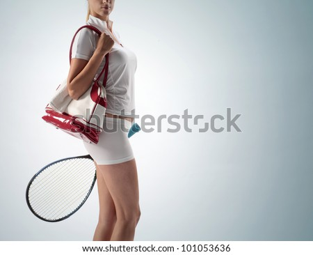 young woman with a sports bag and racket tennis - stock photo