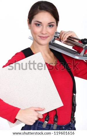 Young woman with a tile cutter - stock photo