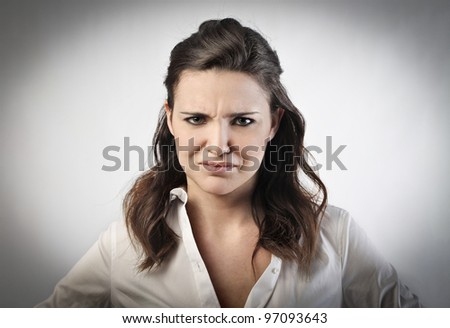 Young woman with aggressive expression - stock photo