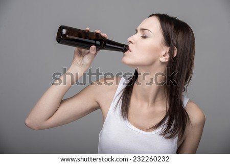 Young woman with alcohol. The concept of bad habits. - stock photo