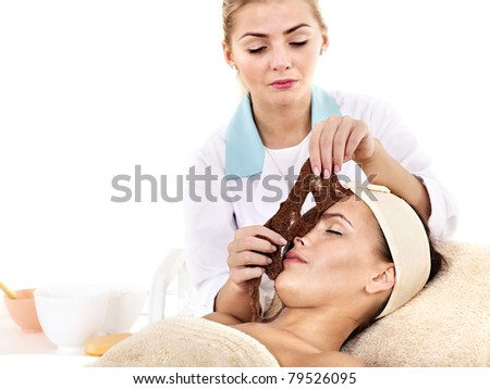 Young woman with algae facial mask.