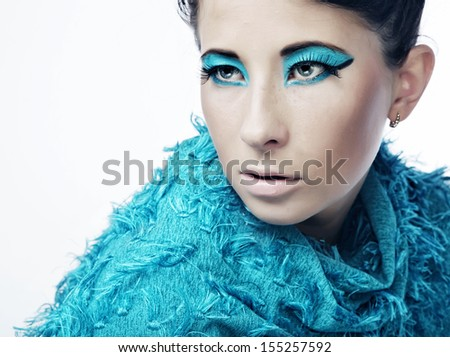 Young woman with amazing hairstyle in blue dress.  - stock photo
