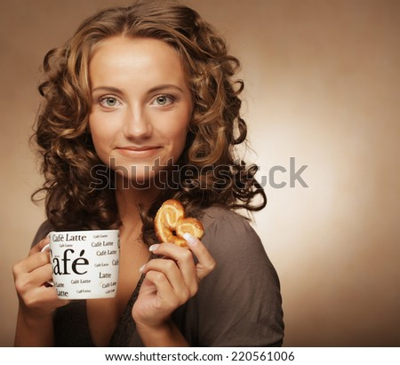 Young woman with an aromatic coffee in hands  - stock photo