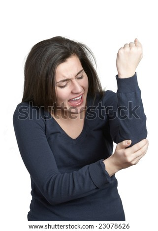 Young woman with an elbow injury on white background - stock photo
