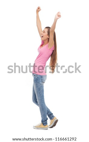 Young woman with arms raised - stock photo