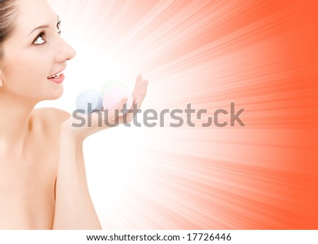 young woman with aromatic balls for spa - stock photo