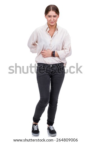 Young woman with back and abdominal pain, holding her belly with a pained expression, isolated on white - stock photo