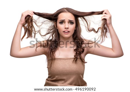Young woman with bad hair isolated on white