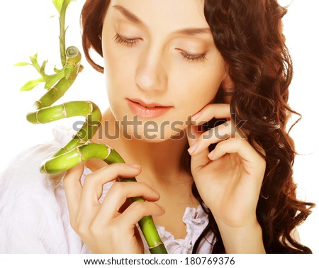 young woman with bamboo. - stock photo