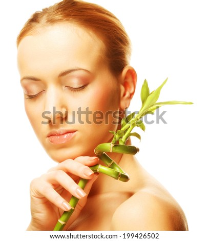 young woman with bamboo - stock photo