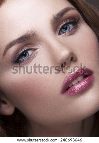 Young woman with beautiful healthy face with pink lipstick - stock photo