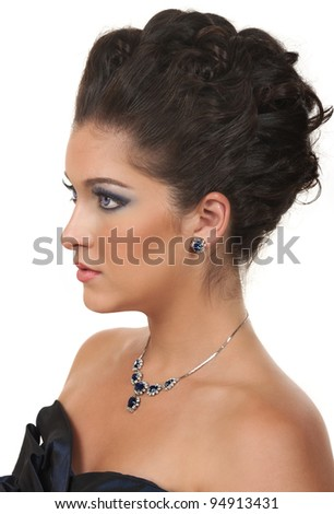 Young woman with beautiful make up, hairdo and sapphire  diamond jewelry - stock photo