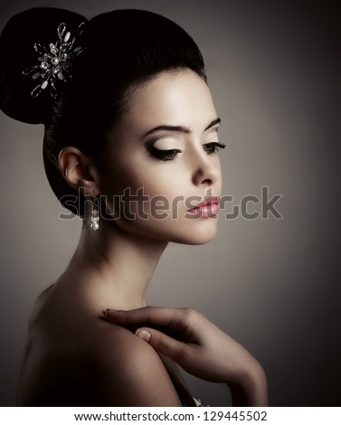 Young woman with beautiful make-up, look down. - stock photo