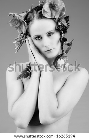 Young woman with big flowers in her hair