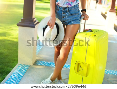 Young woman with big luggage at airport happy of her vacation at warm country on holidays.tanned girl with large suitcases in the airport,holding straw hat,pink sunglasses,tropical elegant and sexy - stock photo