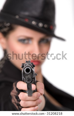 Young woman with black gun over white background
