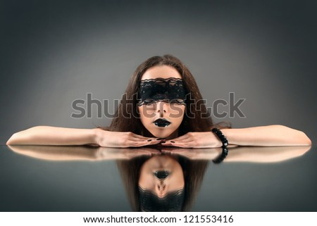 young woman with black lace on her eyes - stock photo