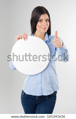young woman with blank circle board and showing thumb up sign - stock photo