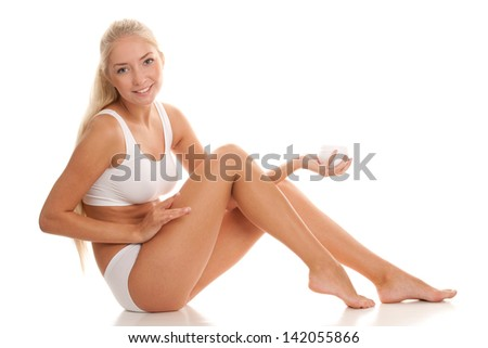Young woman with body lotion - stock photo