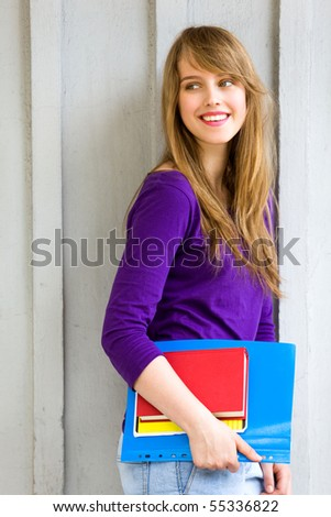 Young woman with books - stock photo