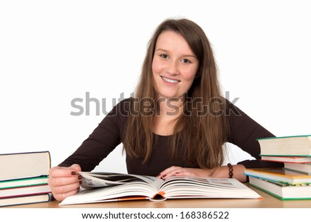 young woman with books is smiling