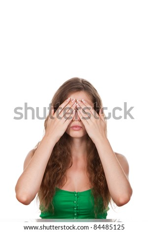 Young woman with both hands in cover her eyes against white background - stock photo