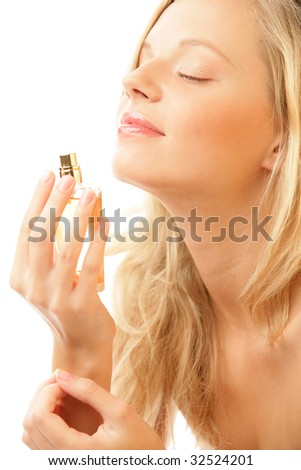 Young woman with bottle of perfume isolated on white background - stock photo