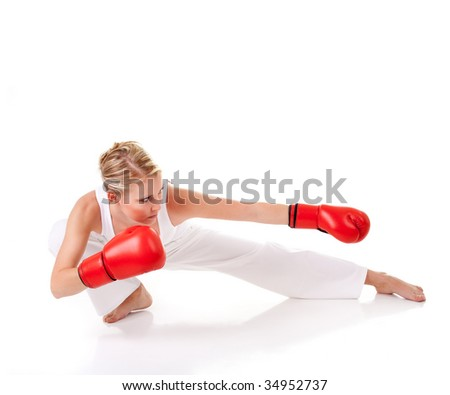 Young woman with boxing glove - stock photo