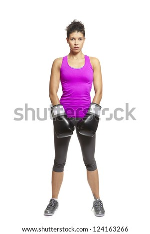 Young woman with boxing gloves sparring in sports outfit