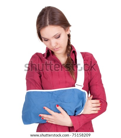 young woman with broken hand wearing an arm brace - stock photo