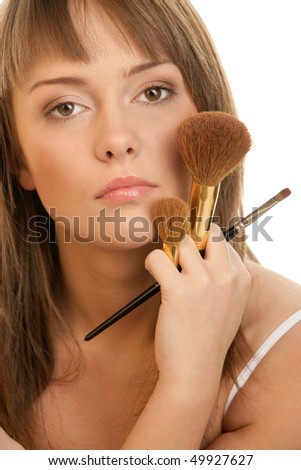 Young woman with brushes - stock photo
