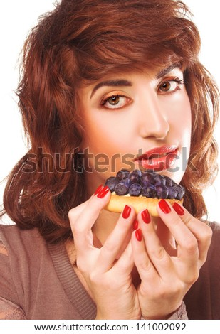 Young woman with cake with fresh berries