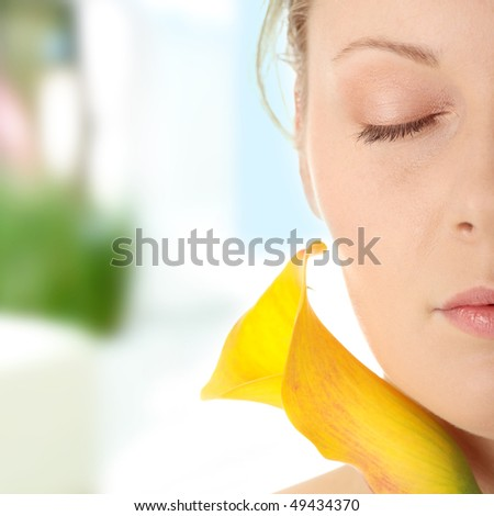 Young woman with calla - stock photo