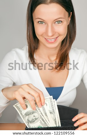 young woman with cash - stock photo