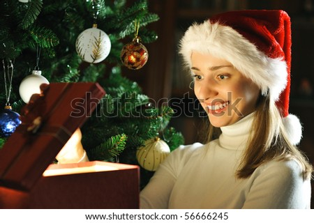 Young woman with Christmas present - stock photo