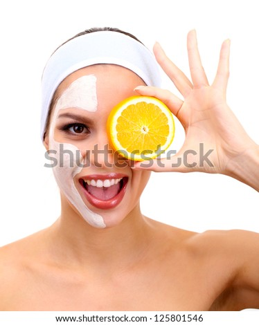 Young woman with clay facial mask, isolated on white - stock photo