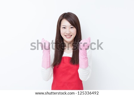 young woman with cleaning gloves - stock photo