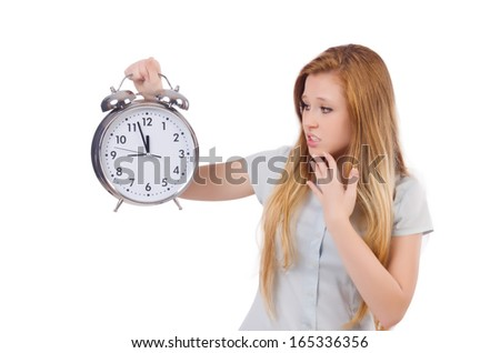 Young woman with clock on white - stock photo
