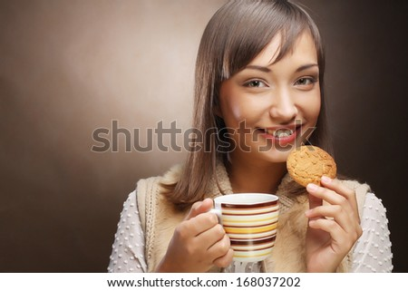 young woman with coffee and cookies - stock photo