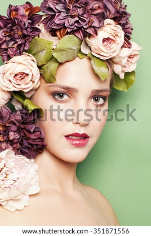 young woman with colored flowers on her head