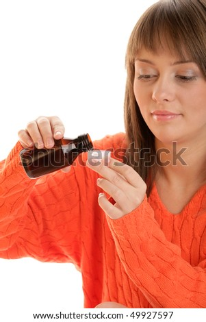 Young woman with cough syrup - stock photo