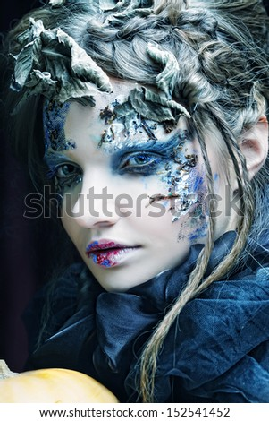 Young woman with creative make up. Halloween theme.  - stock photo